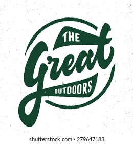 'The Great Outdoors' vintage retro t shirt apparel fashion graphic. Hand crafted hand lettered design. Typographic badge sign symbol. textured vector illustration.
