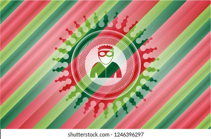 thief icon inside christmas colors badge.