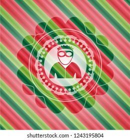 thief icon inside christmas style emblem.