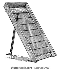 This illustration represents Sand Screen which used to sift out pebbles stones and shells from sand, vintage line drawing or engraving illustration.