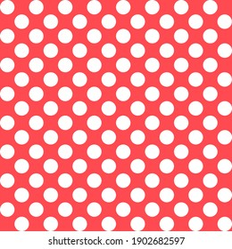This is a seamless pattern of polka dots on a red background.