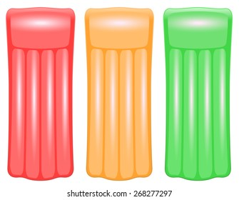 Three air mattresses in traffic light colors red, orange and green
