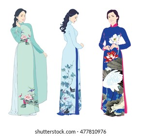 Three beautiful young women wearing traditional costumes of Vietnam, floral aodai long dresses. Isolated on white background.
