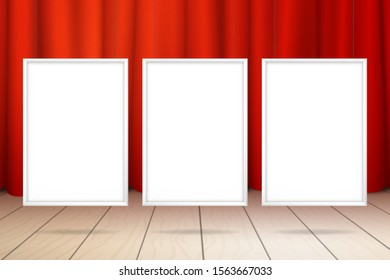 Three blank white frames hanging on the strings. Red curtain and wooden floor. Realistic mockup for design with shadow