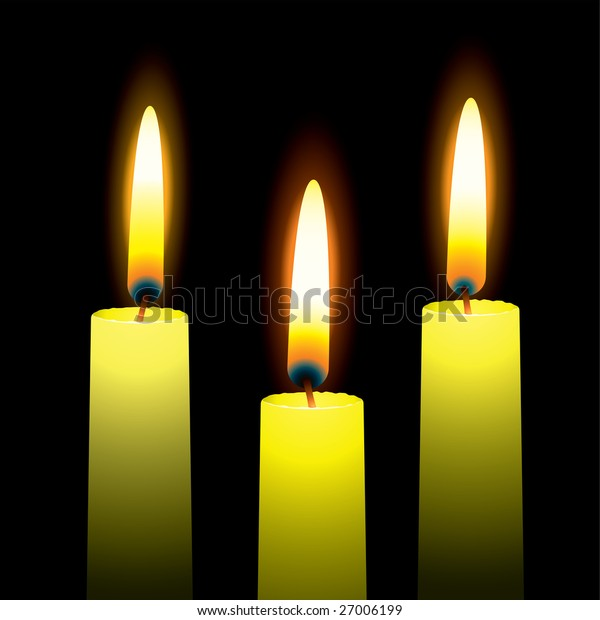 Three burning candles with yellow wax and outer glow
