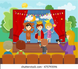 Three children in costumes performing theater play on stage. Little children dressed as a prince, princess and bear. Theatrical performance at kindergarten or school