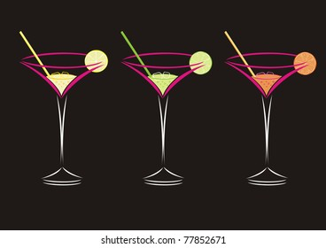 Three cocktails in martini glasses isolated on a black background