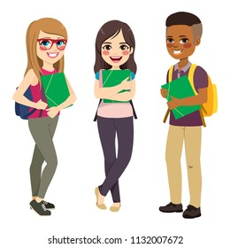 Three cute happy young students standing holding green folder