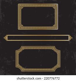 Three gilt decorated frames on a dark shabby background