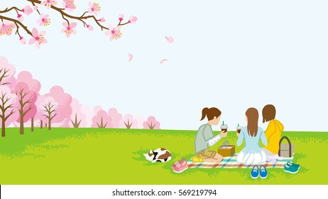 Three girls picnic in spring nature