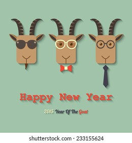 three goats wearing glasses with 2015 year of the goat sign. vector.