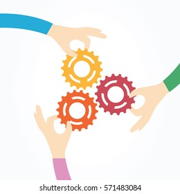 Three hands holding gears together. Teamwork, partnership, business, cooperation and management concept.
