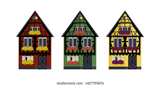 Three houses of different colors in Alsaces style. Green, red and yellow houses in Alsaces style.