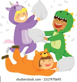 Three kids having a pillow fight while wearing animal onesie jumpsuits in a slumber party.