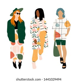 Three ladies dressed in trendy clothes standing in various poses. Fashion look.  Female faceless characters. Hand drawn colored vector set. All elements are isolated