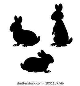 Three little rabbits. Vector black silhouettes on white background