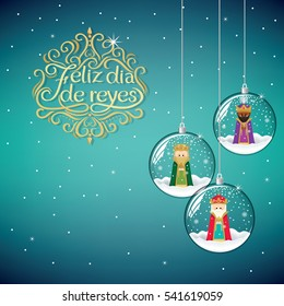 the three magic kings in Christmas decoration ball. Happy Epiphany written in Spanish.