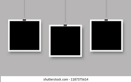 Three photo frames hanging on a clip. Vector illustration