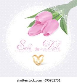 Three Photo realistic pink tulips in the upper right corner and bridal floral lace in round frame on a white background. Pink calligraphic text Save the date and wedding rings in heart shape.