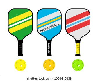 Three pickleball rackets and balls