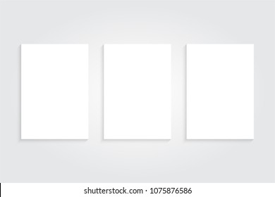 Three Realistic White Poster Mockup. Empty White Vector Poster Template with Shadow Effect. 3D Illustration.