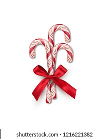 Three red striped candy canes with red bow isolated on white background. Vector Christmas and New Year design element