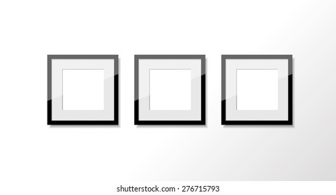 Three square photo frames in the row on the white wall