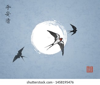 Three swallow birds on night sky background. Traditional Japanese ink wash painting sumi-e with swallows and the moon. Hieroglyphs - peace, tranquility, clarity