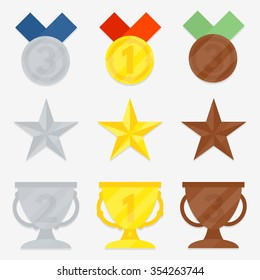 Three variations of awards. Star, cup, medal. Gold, silver, bronze. The first, second, third place.