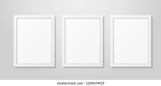 Three Vector Realistic Modern Interior White Blank Vertical A4 Wooden Poster Picture Frame Set Closeup on White Wall Mock-up. Empty Poster Frames Design Template for Mockup, Presentation