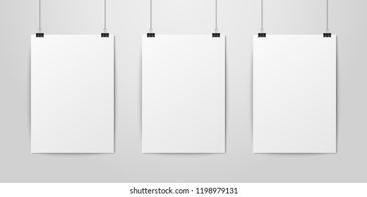 Three Vector Realistic White Blank Vertical A4 Paper Poster Hanging on a Rope with Binder Clip Set on White Wall mock-up. Empty Poster Design Template for Mockup