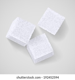 Three white sugar cubes with shadow on grey background