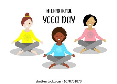 Three young girls sitting in a lotus pose. International yoga day.