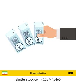 Throwing three Iranian rial. Iranian rial banknote.