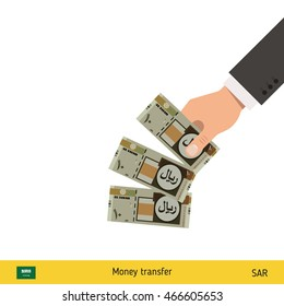 Throwing three riyal. Saudi Arabian riyal banknote.