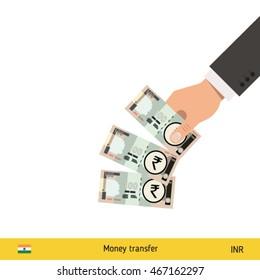 Throwing three rupee. Indian rupee banknote.