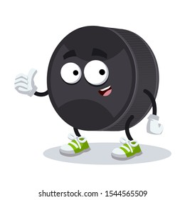 thumbs up cartoon black rubber hockey puck character mascot smiling on white background