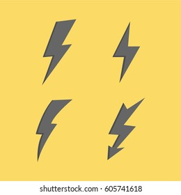 Thunderbolt signs on yellow background. Set of vector flash icons.vector lightning silhouettes