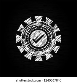 tick icon drawn on a chalkboard