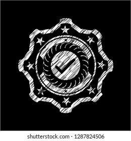 tick icon inside chalkboard emblem written on a blackboard