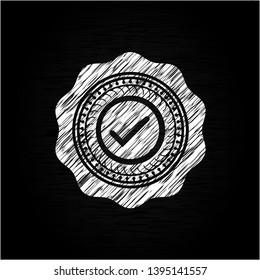 tick icon inside chalkboard emblem