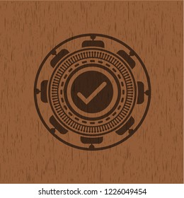tick icon inside retro wood emblem
