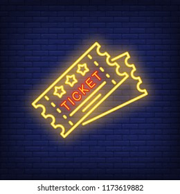 Tickets neon icon. Cards shape with stars and Ticket lettering on brick wall background. Performance concept. Vector illustration can be used for neon signs, advertising, show invitation