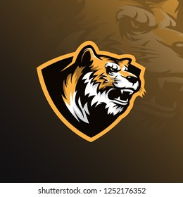 tiger mascot logo design vector with modern illustration concept style for badge, emblem and tshirt printing. angry tiger head illustration with shield.