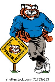 Tiger standing, leaning on a sign, strong and tough which gives tribute to traditional school mascots but with a new look and attitude. Suitable for all sports.