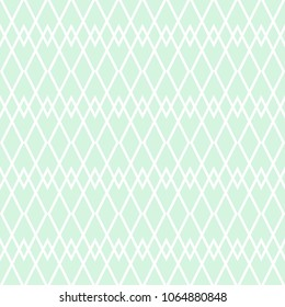 Tile vector pattern with white plaid on pastel green background