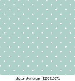 Tile vector pattern with white polka dots on pastel green background