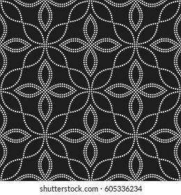 Tiled seamless geometric pattern of dotted petals and flowers. Floral trellis motif. Beads. Abstract black and white mosaic background. Vector illustration.