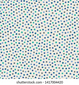 Tiny blue, green and grey stars on a white background in seamless repeat pattern. Sweet tossed vector design ideal for children and background projects.