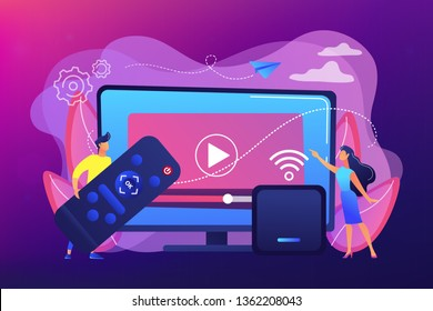 Tiny people watch video with remote control and television multimedia box. Smart TV box, smart tv console, make your TV smart concept. Bright vibrant violet vector isolated illustration